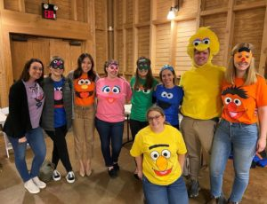Group shot of HGS lawyers and staff dressed in Sesame Street t-shirts.